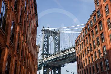 Brick wall buildings and Manhattan Bridge in Brooklyn New...