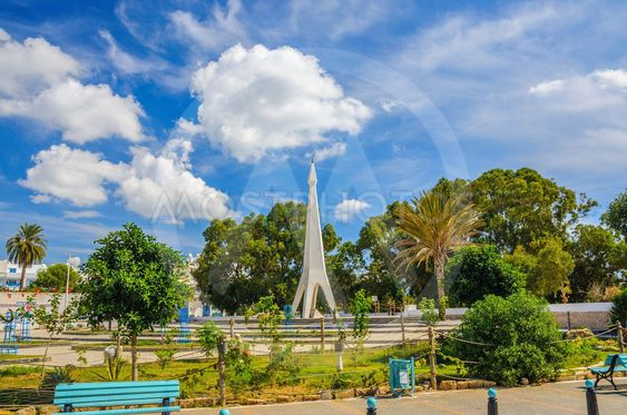 Monument with blue sky and trees near Medina in Hammamet...