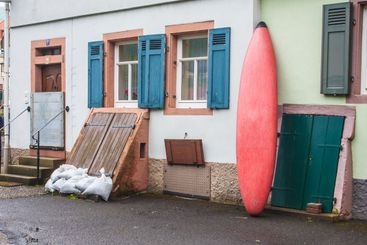 Local residents protect houses from imminent flooding