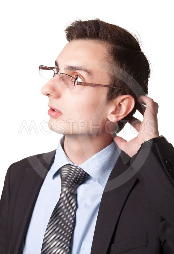Young businessman in glasses thinking
