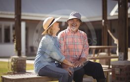 Senior couple sitting together on bench