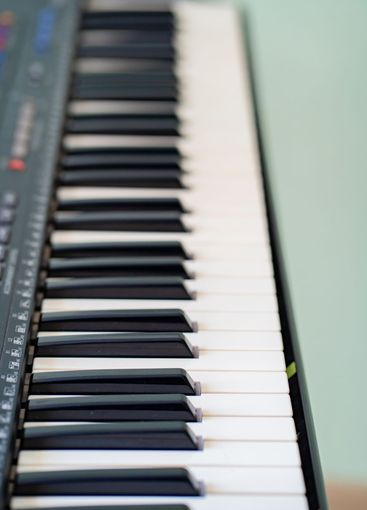 black and white piano keys synth. close-up.