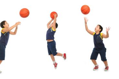 Boy playing basketball isolated