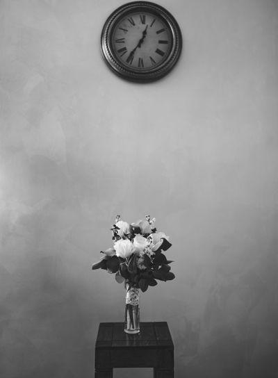bridal bouquet of white tulips, delphinium, salal,...