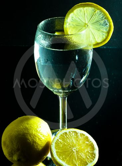 lass of water and lemon