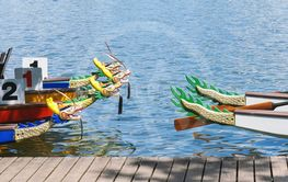 dragon boats moored at wooden jetty