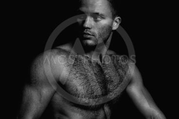 Portrait of a handsome naked muscular guy. Black and white