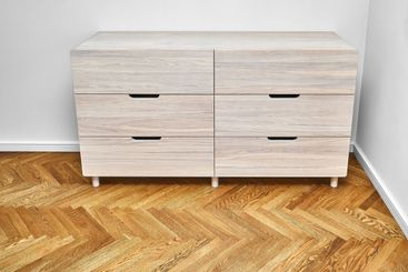 Chest of drawers with bleached solid oak stands on...