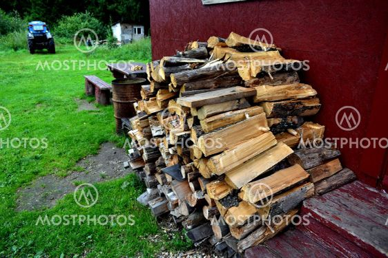 wood for the stove against the wall