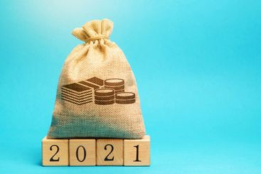 Money bag and wooden blocks 2021. Budget planning....