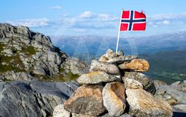 A Norwegian flag on the mountain top