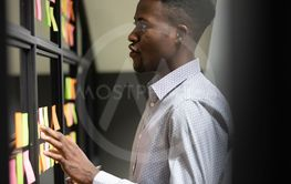 Focused male african businessman checking work plan on...