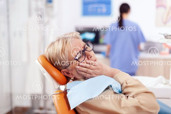 Elderly patient waiting diagnostic from dentist doctor