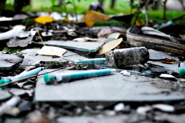 narcotic syringes in the junkyard