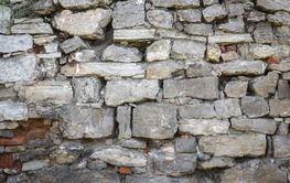 Texture of a stone wall. Old stone wall texture background.
