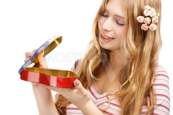 Beautiful young smiling woman with gift heart shape box