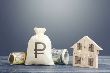 Russian ruble money bag and puzzle house. Mortgage loans...