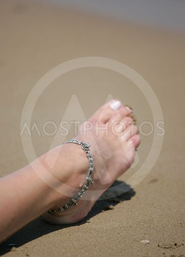 Woman's foot on the beach