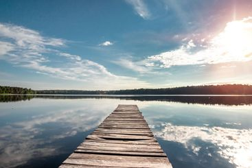 Wooden pier on the background of a beautiful lake summer...