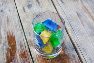 Colorful ice cubes in a glass
