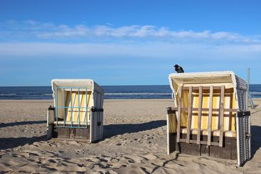 Two closed beach chairs at end of summer season