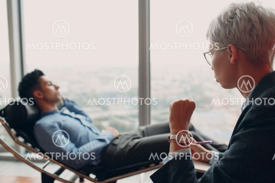 Consultation of young male patient on reception for...