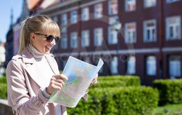 travel and vacation concept - young woman tourist...