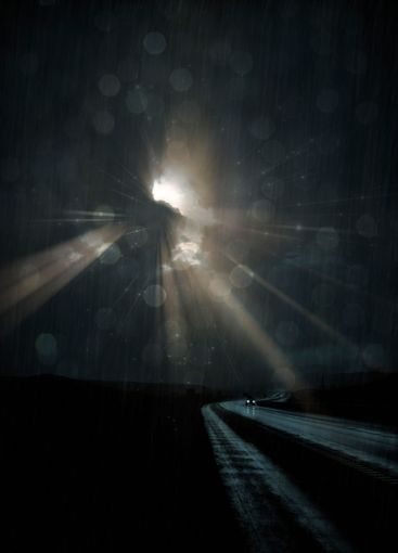 Lonely Road with light rays
