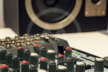 Close-up sound mixer detail for music mix.