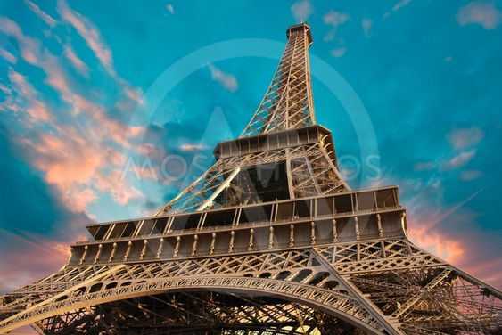 Eiffel Tower at Sunset against a Cloudy Sky