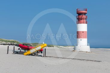Lighthouse and rescue boats at beach of Dune, island near...