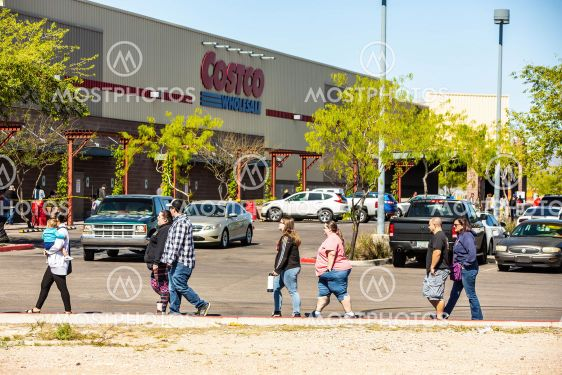 Soical distancing outside a wholesale warehouse during...