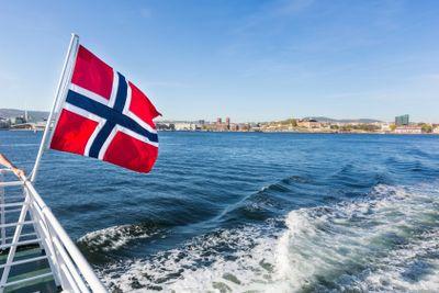 Norwegian flag waving on poop of a boat in Oslo