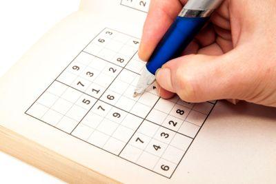 hand making a sudoku