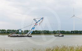 tugboat and industrial platform over the river