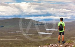 Scottish highland landscape: boy hiking in Glencoe...
