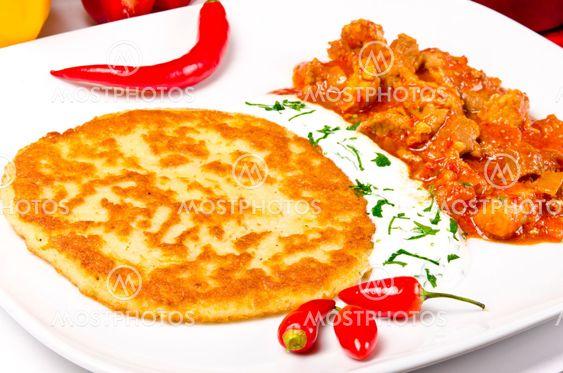 Hungarian goulash with potato pancakes