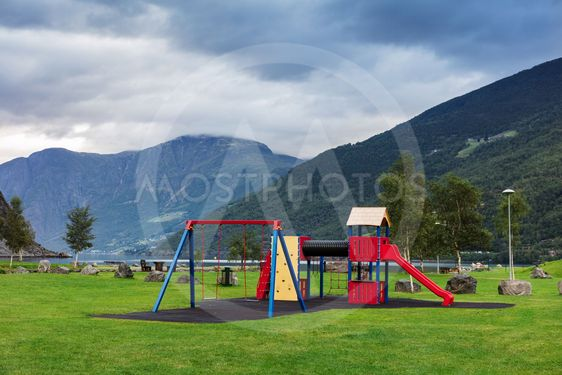 playground in the park on the shore of the fjord