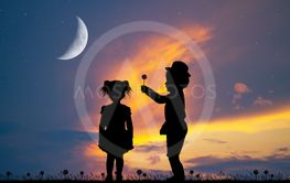 child gives a dandelion to the little girl