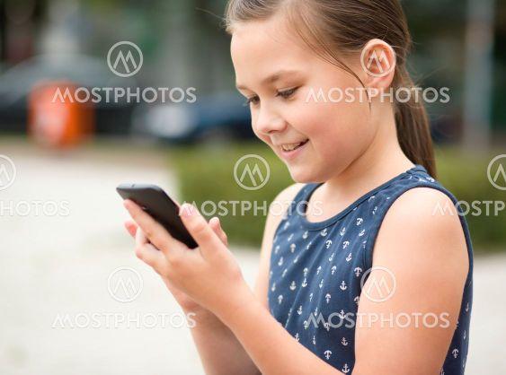 Little girl is using smartphone