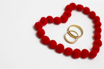 Gold wedding rings in red heart
