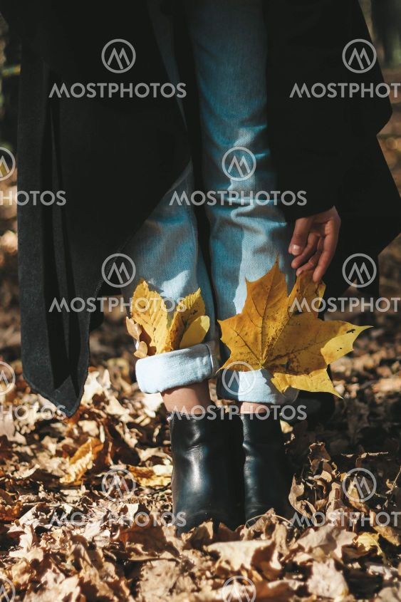 autumn yellow leaves in boots for a girl autumn