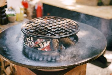 Round grill with flat roasting. Round grille in the...