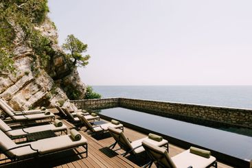 Sun-tanning sun loungers by the pool on Sveti Stefan...
