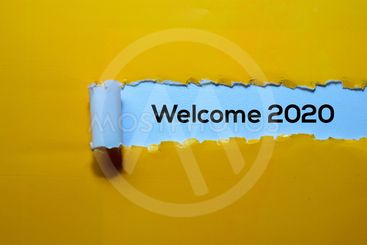 Close up Welcome 2020 written in yellow torn paper