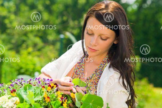 Summer garden beautiful woman care color flowers