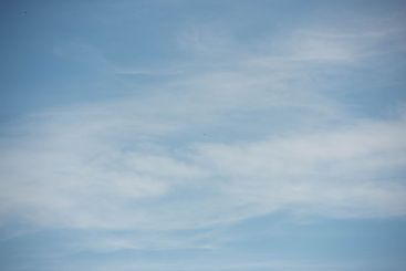 picture of a blue sky with soft clouds