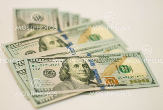 Stacks of paper 100 dollars USA on the white background