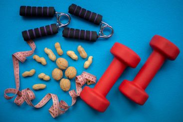Nuts, measuring tape, hand grip strengthener and dumbbells