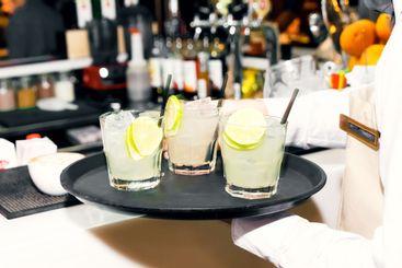 Lemonade with fresh lemon and rosemary in glass on...